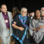 Vision Quest Elder Mae Louise Campbell and Honourary Chair Morris Shannacappo walking and greeting people